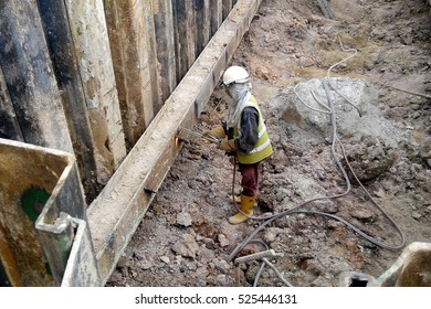 SELANGOR, MALAYSIA  ?? AUGUST 21, 2015: Workers cutting reinforcement bar using blowtorch at construction site in Selangor, Malaysia on August 21, 2015.