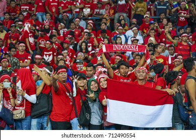 SELANGOR, MALAYSIA - AUGUST 26, 2017 :  Indonesia football fans during men's football Group B round match of the 29th Southeast Asian Games (SEA Games) against Malaysia at Shah Alam Stadium.