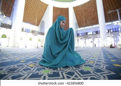 SELANGOR MALAYSIA, circa May 2015: Unidentified muslim women showing pray cloth before performs pray.