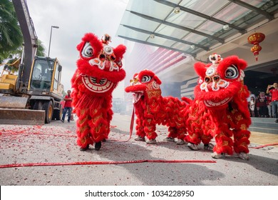 SELANGOR, MALAYSIA - February 23, 2018 : Dragon dan lion dance performances with firecrackers at the Space U8 shopping mall in Shah Alam, Malaysia in conjunction with Chinese New Year celebrations.