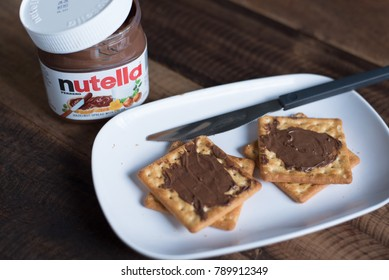 selangor, Malaysia - Jan 9th 2018 : nutella chocolate spread on wooden table. Nutella is manufactured by the Italian company Ferrero that was first introduced in 1965