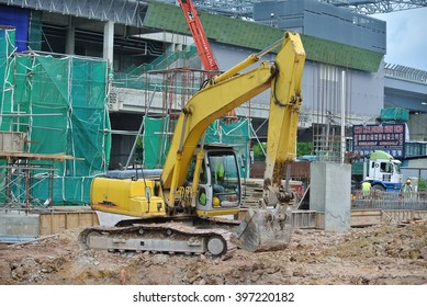 SELANGOR, MALAYSIA -JANUARY 02, 2016: Excavators is heavy construction machine used to do soil excavation work at the construction. Powered by long hydraulic arm with basket. Handle by workers.