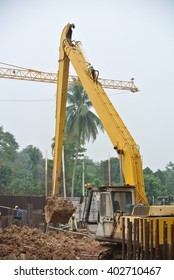 SELANGOR, MALAYSIA -JANUARY 02, 2016: Excavators machine is heavy construction machine used to do soil excavation work at the construction. Powered by long hydraulic arm with basket.