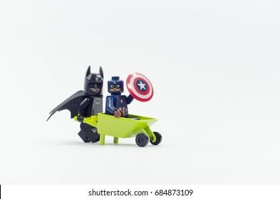 selangor, malaysia. july 25, 2017. lego batman pushing wheelbarrow with captain america sitting on it. Lego minifigures are manufactured by The Lego Group.