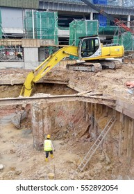 SELANGOR, MALAYSIA -JULY 28, 2016: Excavators machine is heavy construction machine used excavate soil at the construction. Powered by long hydraulic arm with bucket. Operate by workers.