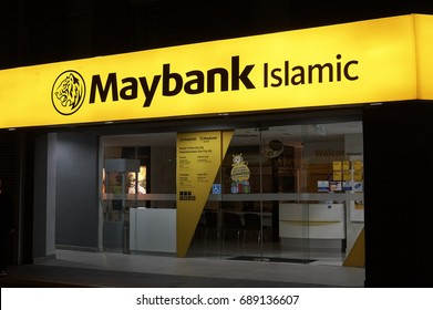 SELANGOR, MALAYSIA - JULY 30, 2017 : Maybank Islamic signage at one of their retail branches during night time. Maybank Islamic Berhad is ranked as the top Islamic bank in Asia Pacific.