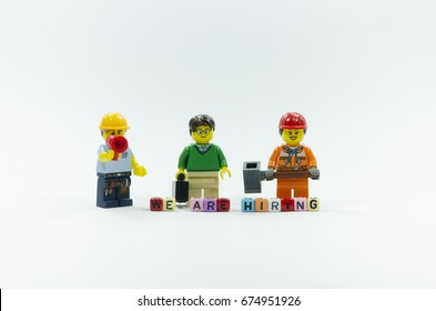 selangor, malaysia. june 4, 2017. Lego worker with word we are hiring using colorful beads isolated on white background. Lego minifigures are manufactured by The Lego Group.