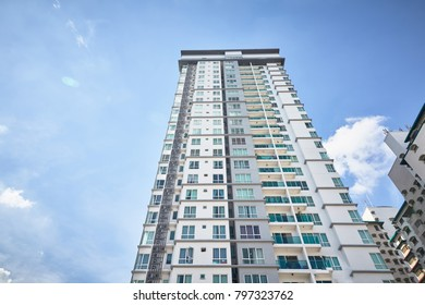 Selangor, Malaysia - June 6th 2017: Look up view of modern condominium architecture against a beautiful sky at Petaling Jaya, Malaysia.