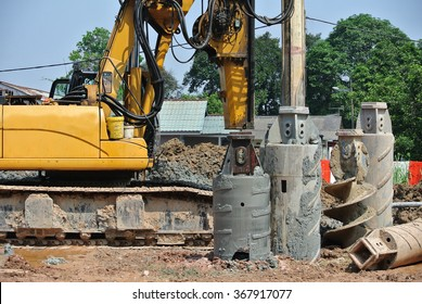 SELANGOR, MALAYSIA â?? MARCH 05, 2015: Bore pile rig auger at the construction site in Malaysia on March 05, 2015. This heavy machine used during the foundation work.