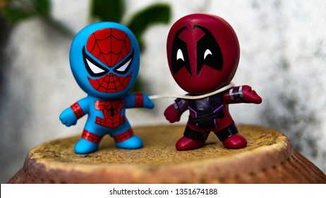 Selangor , Malaysia - March 28, 2019: Two McDonald's toy Spiderman use his webs to fight Deadpool.