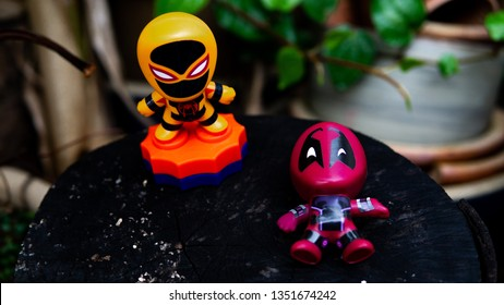 Selangor , Malaysia - March 28, 2019: Two McDonald's toy Deadpool lay on the ground and Spiderman stand up.
