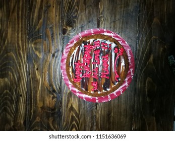Selangor, Malaysia - May 12, 2018: Secret recipe salted caramel cake for a mother's birhday celebration on a wooden background.