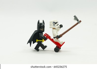 selangor malaysia. MAY 21, 2017. Lego batman and Lego storm trooper taking photo on trolley wheels, isolated on white background. Lego minifigures are manufactured by The Lego Group.