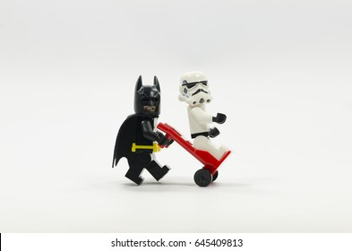 selangor malaysia, MAY 21, 2017. Lego batman  pushing a trolley with lego storm trooper on it. isolated on white background.
