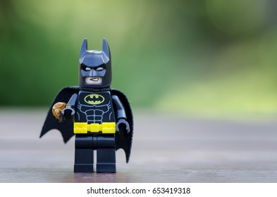 selangor, malaysia. MAY 28, 2017.lego batman and a beetle on his hand. Lego minifigures are manufactured by The Lego Group.