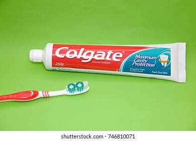 SELANGOR, MALAYSIA - November 1, 2017: Colgate toothpaste and toothbrush on a green surface. Colgate manufactures oral hygiene products such as toothpastes, toothbrushes, mouthwashes and dental floss.