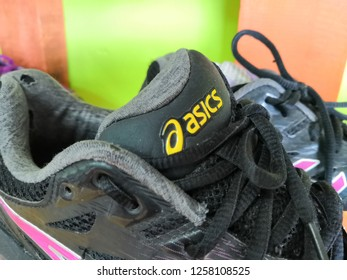 Selangor, Malaysia- November 2018 : Closeup on outdoor shoes from ASICS brand on shelf display in the  shop for sale. ASICS is a Japanese corporation produces footwear and sports equipment