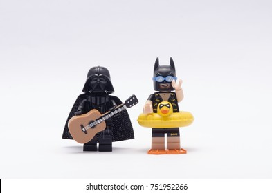 selangor, malaysia, oct 25, 2017. Darth vader playing holding a guitar with vacation batman beside him.  Lego minifigures are manufactured by The Lego.
