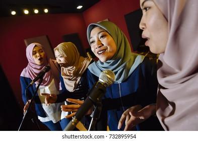 Selangor, Malaysia - October 12, 2017 : Muslims women are singing together in studio at Seri Kembangan.