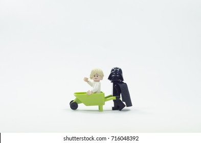 selangor malaysia, sept 10, 2017. Lego luke skywalker sitting in wheelbarrow while darth vader push it. Lego is a brick brand by Lego group.