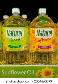 Selangor, Malaysia - Sept 25, 2021: Row of Naturel sunflower cooking oil on supermarket shelf. Naturel has two variants; one original sunflower oil and one blended with canola oil.