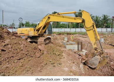 SELANGOR, MALAYSIA SEPTEMBER 05, 2014: Excavators is heavy construction machine used to do soil excavation work at the construction site in Selangor, Malaysia