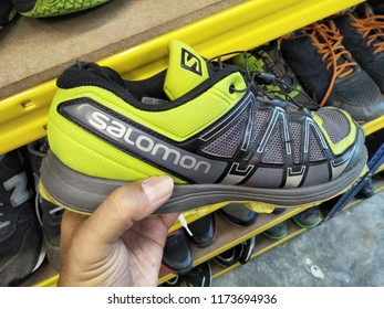 Selangor , Malaysia - September 2018 : Closeup on hand holding Salomon shoe brand at the sneakers store. The Salomon Group is a sports equipment manufacturing company that originated inFrance.