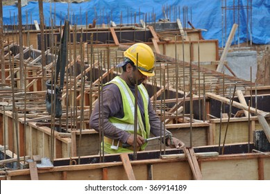 SELANGOR, MALAYSIA  SEPTEMBER 22, 2015: Construction workers fabricating ground beam timber form work at construction site in Selangor Malaysia.