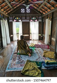 SELANGOR, MALAYSIA-SEPTEMBER 15, 2019 : An unidentified Muslim Malay man make a supplication doa in a breezy praying room of a traditional Malay home.