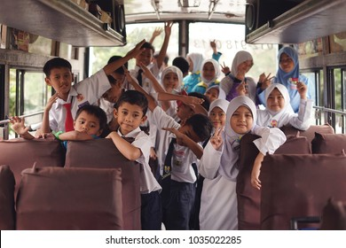 Selangor,Malaysia - 27 February 2018 : Happily Malaysian pupil in the school bus before heading to the school at Selangor.