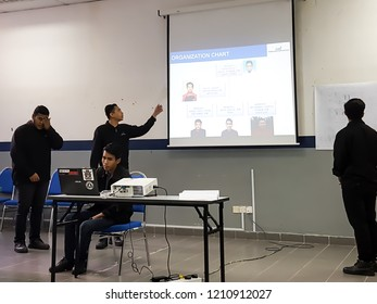 SELANGOR,MALAYSIA - SEPTEMBER 24, 2018: Unidentified group of students are presenting their final year project infront of examiners in a room.