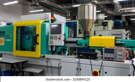 SELANGOR,MALAYSIA-FEBRUARY 23,2018: Plastic injection molding machine in a modern hi-tech factory
