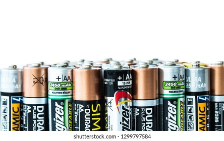 SELBY, UK - JANUARY 30, 2019. A close up of an assortment of disposable and rechargeable batteries of various brands on an isolated white background with copy space.