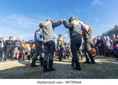 Selcuk, Turkey - January 18, 2015 : Turkish Efe's are dancing in Selcuk Arena Izmir, Turkey during camel wrestling.
