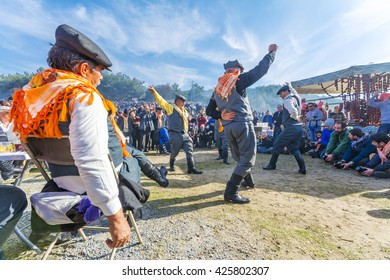 Selcuk, Turkey - January 18, 2015 : Turkish Efe's are dancing in Selcuk Arena during camel wrestling.Camel wrestling is populer attraction in Aegean part of Turkey.