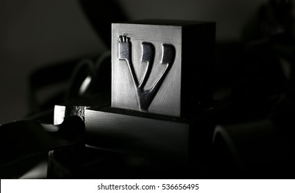Select focus & artistic light on -Tefillin -[Jewish phylactery] with black straps isolated on a dark blackground
