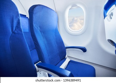Select focus on modern commercial airplane seat in cabin.