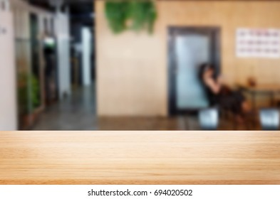 Selected focus empty brown table of wood and room interior background blur background with bokeh image. for your photomontage or product display
