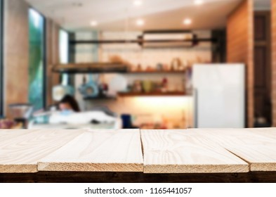Selected focus empty brown wooden table and Coffee shop or restaurent blur background with bokeh image. for your photomontage or product display