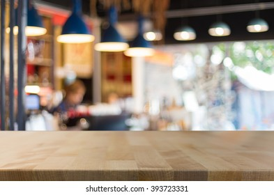 Selected focus empty brown wooden table and Coffee shop blur background with bokeh image, for product display montage.