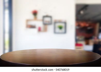 Selected focus empty brown wooden table and Coffee shop or restaurent blur background with bokeh image. for your photomontage or product display.