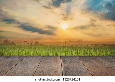 Selected focus empty wooden table and view of sunset blur background with bokeh image. for your photomontage or product display.