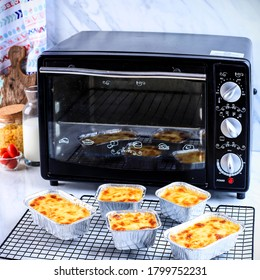 Selected Focus Fresh Baked Macaroni Schotel or Macaroni and Cheese in an Alumunium  Foil Bowl