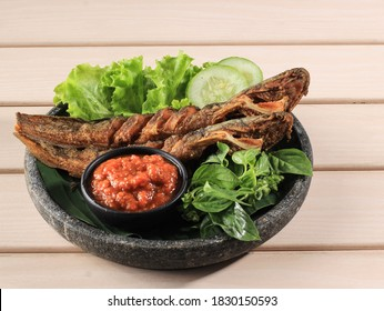 Selected Focus Lele Goreng or Fried Catfish is Traditional Indonesian Culinary Food. Catfish and Chilli Tomato Paste, Popular Street Food Called Pecel Lele Lamongan