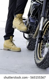 Selected focus of man boots with motorcycle