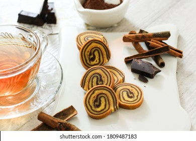 Selected Focus Small Mini Lapis Legit Roll, Delicious Traditional Cake from Indonesia with Spice and Cinnamon. White Background and White Choppingboard.
