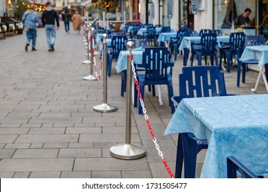 Selected focus at vacant outdoor tables and seats area of restaurant without customer during social distancing and global quarantine from epidemic of COVID-19 virus. Impact of COVID-19 at restaurant.