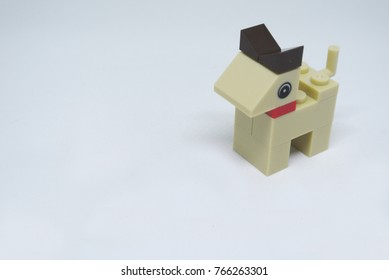 Selected focused on the shape of a dog made of plastic toy blocks and isolated on white background