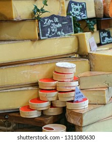 Selection of Aged Cheese for Sale at Market
