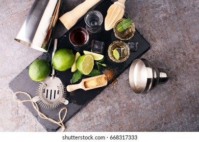 Selection of alcoholic drinks on black rustic stone plate